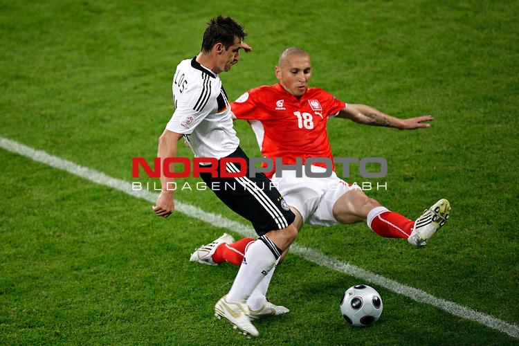 UEFA Euro 2008 Group B Klagenfurt - W&ouml;rthersee Match 04 <br /> <br /> Deutschland ( GER ) - Polen ( POL )<br /> <br /> Zweikampf zwischen Miroslav Klose ( Germany / Angreifer / Forward /  Bayern Muenchen #11) und Mariusz Lewandowski  ( Poland / Mittelfeldspieler / Midfielder / Shakhtar Donetsk # 18 )<br /> <br /> <br /> Foto &copy; nph (  nordphoto  )<br /> <br /> <br /> <br />  *** Local Caption ***
