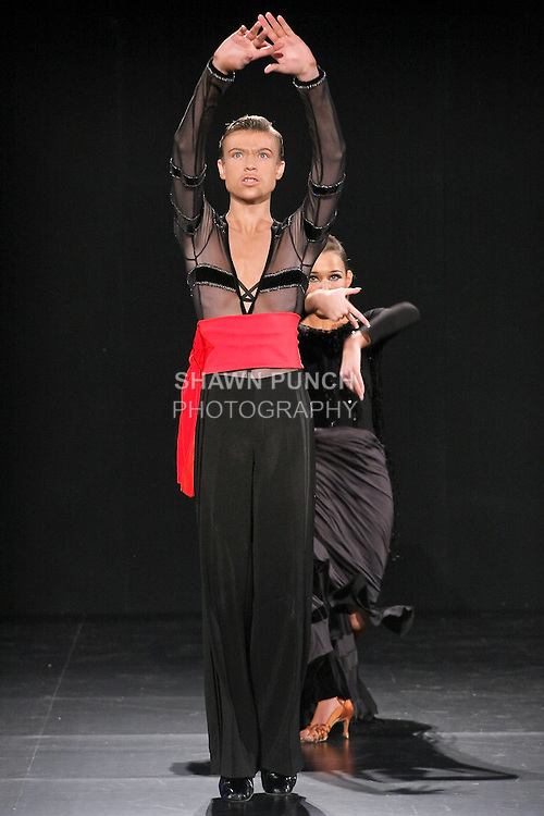 Dancers performs during Couture Fashion Week Fall 2011 in New York City.