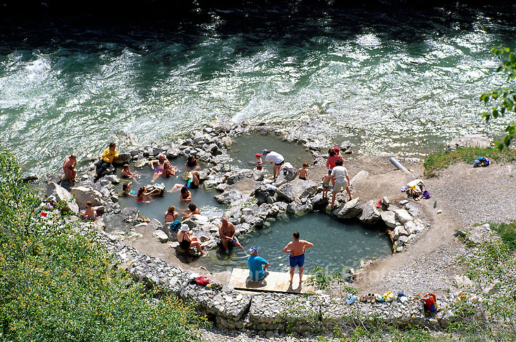 People soaking in Lussier Hot Springs beside Lussier River, Whiteswan Lake Provincial Park, BC, British Columbia, Canada