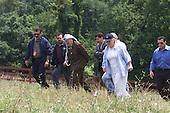 United States Secretary of State Madeleine Albright and Palestinian Authority Chairman Yasser Arafat walk together near Hillsboro, Virginia on Saturday, July 22, 2000.  From left to right:  Yousef Al-helo, Mohammad Al-daya, Chairman Arafat, Dr. Yousef Abdallah, Secretary Albright, Nabil Aburudineh..Mandatory Credit: David Scull - White House via CNP