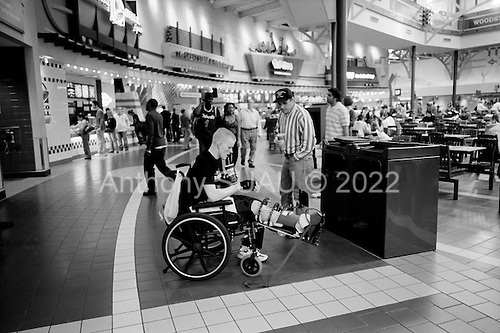 Hanover, Maryland.USA.March 23, 2007..Soldiers injured in the Iraqi war are taken by Walter Reed Medical center for a day trip out of the hospital to the Arundel Mills Mall. Most are recovering from wounds and this is one of their first trips outside the hospital since their injury in Iraq. Most are amputees...In the mall they begin to experience life in a normal setting and must maneuver daily life obstacles including being addressed and stared at by people...Eric Frazier(a double amputee) and Amanda Frazier (18), his wife, from Tennessee shop for music.