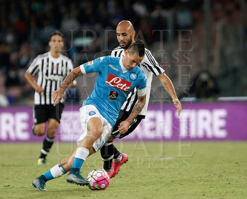 Calcio, Serie A: Napoli vs Juventus. Napoli, stadio San Paolo, 26 settembre 2015. <br /> JNapoli&rsquo;s Marek Hamsik, left, is challenged by Simone Zaza during the Italian Serie A football match between Napoli and Juventus at Naple's San Paolo stadium, 26 September 2015.<br /> UPDATE IMAGES PRESS/Isabella Bonotto