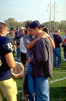 Men age 35 and 21 comforting friend after football game.  St Paul  Minnesota USA