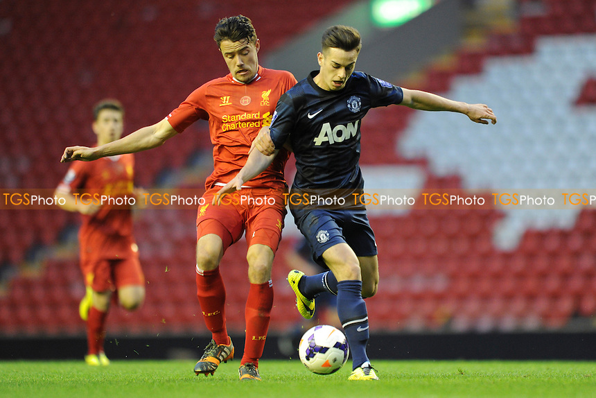 Tom Lawrence of Manchester United battles for the ball with Jordan Lussey of Liverpool - Liverpool Under-21 vs Manchester United Under-21 - Barclays Under-21 Premier League Football at Anfield, Liverpool - 02/05/14 - MANDATORY CREDIT: Greig Bertram/TGSPHOTO - Self billing applies where appropriate - 0845 094 6026 - contact@tgsphoto.co.uk - NO UNPAID USE