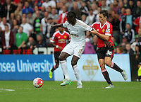 Pictured: Eder of Swansea (L) held back by Matteo Darmian of Manchester United Sunday 30 August 2015<br /> Re: Premier League, Swansea v Manchester United at the Liberty Stadium, Swansea, UK