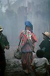Woman walking in traditional embriodered clothes, carrying child,  textiles, San Mateo Ixtatan, Modern Maya, Guatemala, Highlands