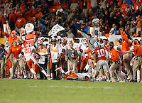 The Clemson bench erupts as Clemson Tigers safety Jayron Kearse (20) catches an interception in the third quarter of the Discover Orange Bowl between Ohio State and Clemson at Sun Life Stadium in Miami Gardens, Florida, Friday night, January 3, 2014. As of the fourth quarter the Ohio State Buckeyes led the Clemson Tigers 35 - 34.(The Columbus Dispatch / Eamon Queeney)