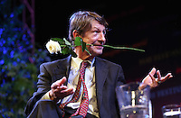 Monday 26 May 2014, Hay on Wye, UK<br /> Pictured: PJ O'Rourke with a rose his mouth.<br /> Re: The Hay Festival, Hay on Wye, Powys, Wales UK.