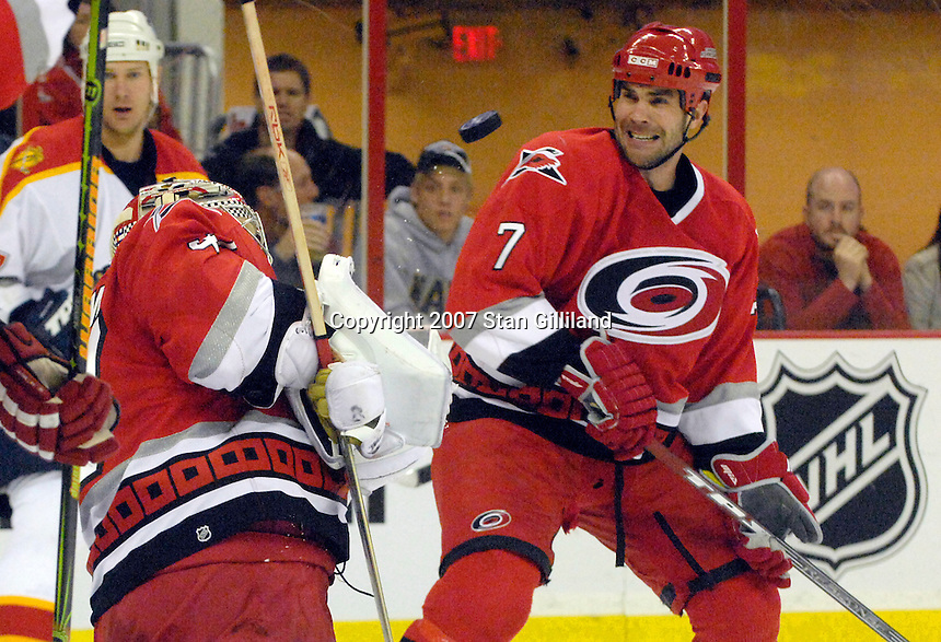 Carolina Hurricanes' John Grahame makes a save as teammate Niclas Wallin (7) keeps his eye on the puck during a game against the Florida Panthers Tuesday, March 13, 2007 at the RBC Center in Raleigh, NC. Carolina won 3-1.