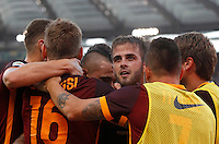 Calcio, Serie A: Roma vs Juventus. Roma, stadio Olimpico, 30 agosto 2015.<br /> Roma&rsquo;s Miralem Pjanic, third from right, celebrates with teammates after scoring during the Italian Serie A football match between Roma and Juventus at Rome's Olympic stadium, 30 August 2015.<br /> UPDATE IMAGES PRESS/Riccardo De Luca