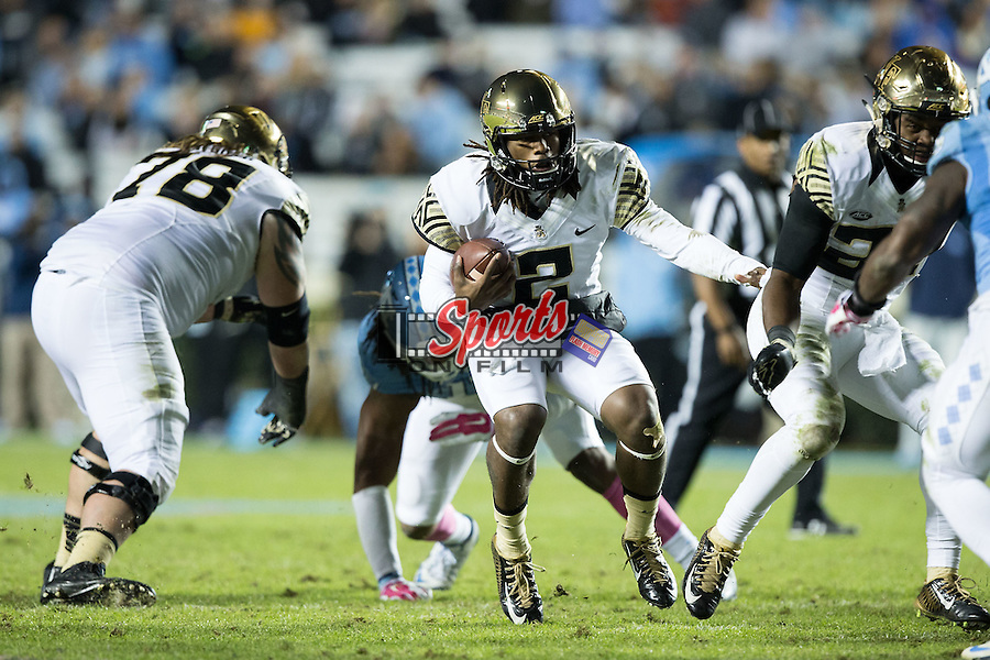 Kendall Hinton (2) of the Wake Forest Demon Deacons runs with the football during second half action against the North Carolina Tar Heels at Keenan Stadium on October 17, 2015 in Chapel Hill, North Carolina.  The Tar Heels defeated the Demon Deacons 50-14.   (Brian Westerholt/Sports On Film)