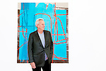 """BEVERLY HILLS: Steve Tisch, Giants Co-Owner and film producer, poses for a portrait in front of Alex Hubbard's """"Untitled, L.A. #1"""" in his newly-unveiled private art gallery on his property in Beverly Hills, California on Thursday, April 19, 2016.  (Photo by Kendrick Brinson)"""