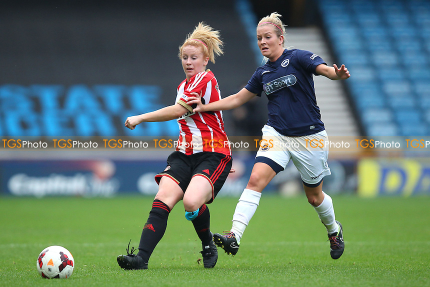 Rachel Furness of Sunderland AFC Ladies evades Lily Agg of Millwall Lionesses - Millwall Lionesses vs Sunderland AFC Ladies - FA Womens Super League Football at Milwall FC, the New Den, London - 26/10/14 - MANDATORY CREDIT: Gavin Ellis/TGSPHOTO - Self billing applies where appropriate - contact@tgsphoto.co.uk - NO UNPAID USE