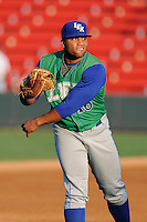 First baseman Alexis Rivera (16) of the Lexington Legends warms up before a game against the Greenville Drive on Friday, August 29, 2014, at Fluor Field at the West End in Greenville, South Carolina. Greenville won, 6-1. (Tom Priddy/Four Seam Images)