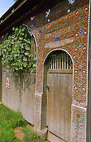 Ornamental carved wood Szekely village farm gate. Transylvania, Romania.
