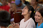 Yolanda Vawhi sings enthusiastically during worship at Knox United Methodist Church in Manila, Philippines. The service is part of a weekday program where the church opens up to poor people in the neighborhood, offering showers, food, fellowship, and an opportunity to worship together.