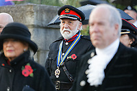 Pictured: A member of the Armed Forces joins local dignitaries during the service. Sunday 11 November 2018<br /> Re: Commemoration for the 100 years since the end of the First World War on Remembrance Day at the Swansea Cenotaph in south Wales, UK.