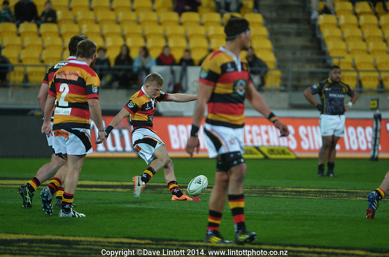 Damien McKenzie kicks for goal during the ITM Cup rugby union match between Wellington Lions and Waikato at Westpac Stadium, Wellington, New Zealand on Saturday, 16 August 2014. Photo: Dave Lintott / lintottphoto.co.nz
