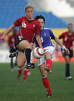 MAR 13, 2006: Faro, Portugal:  USWNT forward (16) Amy Rodriguez collides with  France defender (3) Peggy Provost in the Algarve Cup in Faro Portugal.