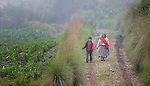 A woman and boy walk along a rural road in San Luis, a small Mam-speaking Maya village in Comitancillo, Guatemala.