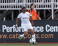 Sky Blue FC forward Monica Ocampo (8) dribbles down the wing. In a National Women's Soccer League (NWSL) match, Boston Breakers (blue) defeated Sky Blue FC (white), 3-2, at Dilboy Stadium on June 30, 2013.