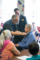 NWA Democrat-Gazette/BEN GOFF @NWABENGOFF<br /> David 'Doc' Kenser (from left), veteran services coordinator with Arkansas Hospice and a vietnam era U.S. Air Force veteran, and Cpl. Aaron Mankin, a U.S. Marine Corps Iraq veteran, recognize Dick Pudas, who served in the U.S. Army from 1954-56, Tuesday, June 4, 2019, during a pinning ceremony for military veterans at Primrose Retirement Communities Assisted Living in Rogers. The program recognized 32 local veterans, most of whom are residents of the facility. The recognition is part of Arkansas Hospice's We Honor Veterans campaign to pay respect to veterans in their later years. Mankin, who works with congressman Steve Womack's office, also shared his story of surviving a bomb blast in Iraq in 2015.