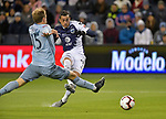 Rogelio Funes Mori (R) of C.F Monterrey scores as Seth Sinovic of Sporting KC tries to block his shot during their CONCACAF Champions League semifinal soccer game on April 11, 2019 at Children's Mercy Park in Kansas City, Kansas.  Photo by TIM VIZER/AFP