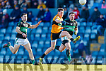 Stephen Cronin and Barry O'Driscoll Nemo Rangers in action against Ronan Shanahan of Austin Stacks during the AIB Munster GAA Football Senior Club Championship semi-final match between Nemo Rangers and Austin Stacks at Páirc Ui Rinn in Cork.