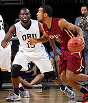 SIOUX FALLS, SD - MARCH 8: Mason Archie II #2 of IUPUI drives defender Obi Emegano #15 of Oral Roberts in the first half of their second round Summit League Championship Tournament game Sunday evening at the Denny Sanford Premier Center in Sioux Falls, SD. (Photo by Dick Carlson/Inertia)