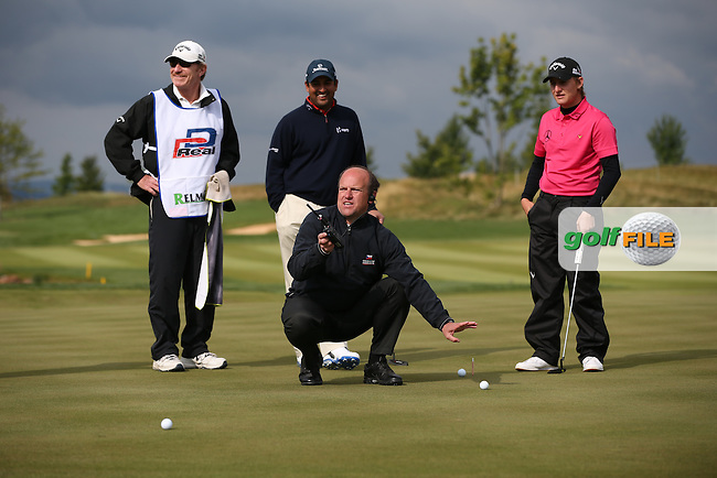 Rules referee relies on spectators to replace collided balls speaks of Emiliano Grillo (ARG) and Shiv Kapur (IND) on the 9th during the Final Round of the D&D Real Czech Masters 2014 from the Albatross Golf Resort, Vysoky Ujezd, Prague. Picture:  David Lloyd / www.golffile.ie