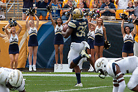 Pitt running back Qadree Ollison (30) scores on a 31-yard touchdown run. The Pitt Panthers football team defeated the Georgia Tech Yellow Jackets 24-19 on September 15, 2018 at Heinz Field in Pittsburgh, Pennsylvania.