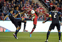 Chicago Fire forward Dominic Oduro (8) and Philadelphia Union defender Michael Farfan (21) simultaneously kick a loose ball.  The Chicago Fire defeated the Philadelphia Union 1-0 at Toyota Park in Bridgeview, IL on March 24, 2012.