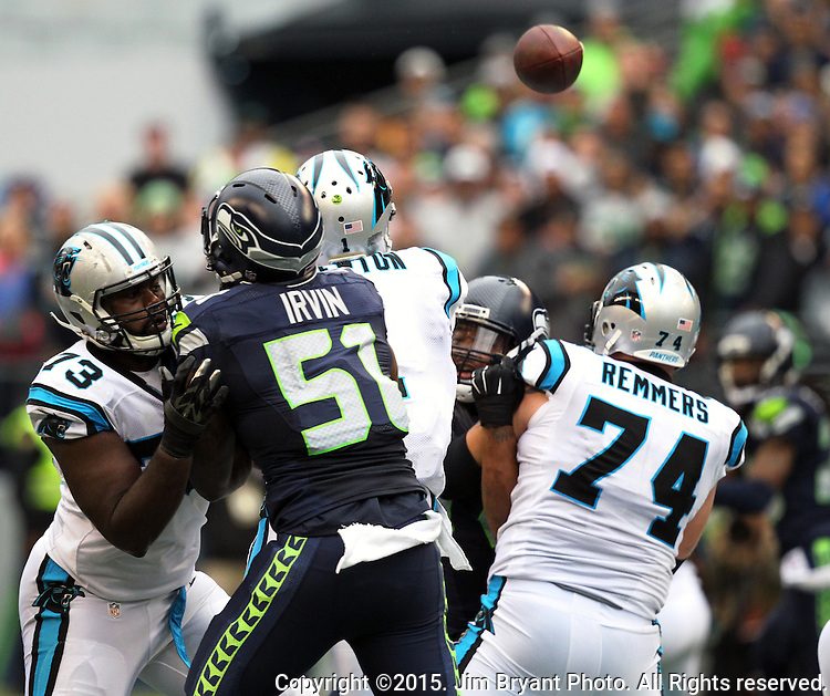 Seattle Seahawks linebacker Bruce Irvin is blocked by  Carolina Panthers tackle Michael Oher (73) while pass rushing Kam Newton  at CenturyLink Field in Seattle on October 18, 2015. The Panthers came from behind with 32 seconds remaining in the 4th Quarter to beat the Seahawks 27-23.  ©2015 Jim Bryant Photography. All Rights Reserved.
