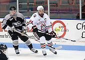 Alex Velischek (Providence - 10), Tyler McNeely (NU - 94) - The Northeastern University Huskies defeated the Providence College Friars 3-1 (EN) on Tuesday, January 19, 2010, at Matthews Arena in Boston, Massachusetts.