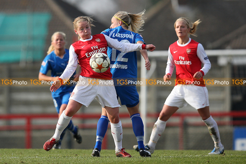 Kim Little of Arsenal tangles with Petra Larsson of Linkoping - Arsenal Ladies vs Linkoping - UEFA Women's Champions League Quarter Final 1st Leg at Boreham Wood FC - 17/03/11 - MANDATORY CREDIT: Gavin Ellis/TGSPHOTO - Self billing applies where appropriate - Tel: 0845 094 6026