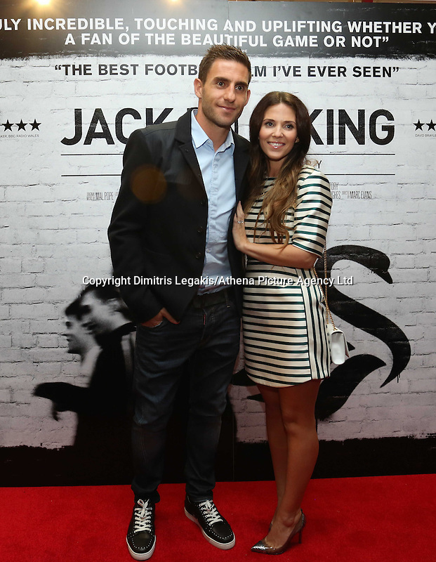 """Pictured: Footballer Angel Rangel with his wife. Sunday 14 September 2014<br /> Re: Film premiere of """"Jack To A King"""" depicting the recent history pf Swansea City Football Club, at the Odeon Cinema, Swansea, south Wales, UK."""