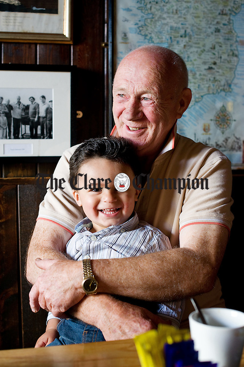 Young Paddy O Donoghue with his grandad P.J. in the family pub O Donoghue's of Fanore which is celebrating 100 years this year. Photograph by John Kelly.