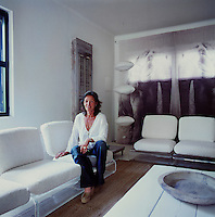 A portrait of interior designer Amelie Thiodet Vigneron seen in her living room.