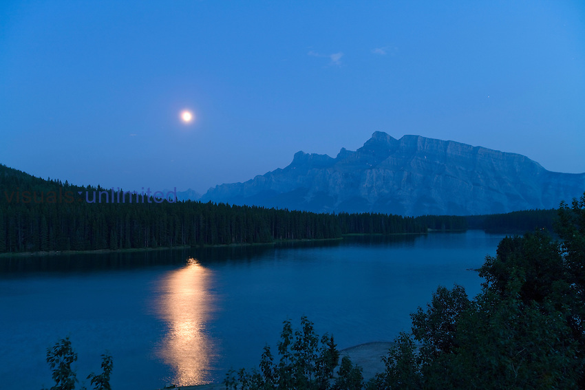 Waxing gibbous Moon over Mt. Rundle and Two Jack Lake, Banff, Alberta, Canada.