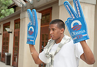 Occidental College students Bobby Phillips '12, Justin Morgan '09 and Darrell Winfrey '12 sell foam Barack Obama hands outside the Samuelson Pavilion (Tiger Cooler) and Johnson Student Center (JSC) on Oct. 31, 2008 for the upcoming 2008 presidential election.<br /> (Photo by Marc Campos, Occidental College Photographer)