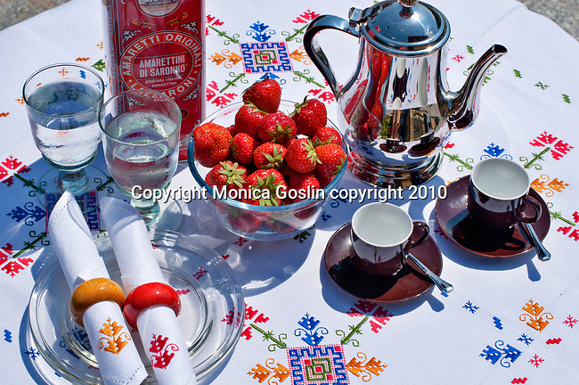 Coffee and fresh strawberries on a summer day in Lake Como, Italy