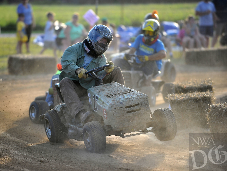 NWA Democrat-Gazette/MICHAEL WOODS • @NWAMICHAELW .... Participants compete in the 5th annual lawnmower races Saturday evening July 25th in Pea Ridge.  The annual event sponsored by the Pea Ridge Lions Club draws lawnmower racing fans from across the region.