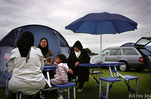 "British Muslims camp out at the four-day ""Living Islam"" festival in northern England in July 2005.....The event, attended by thousands of mainly Pakistani Muslims across the UK, takes place in the Showground of Lincoln, one of England's great cathedral cities.....The event was organised by the Islamic Society of Britain and takes place co-incidentally days after the London bombings by purported Islamic extremists. Organisers said the gathering was a symbol of Muslims celebrating the true meaning of Islam.....There were activities for the family including music, entertainment, sports and speeches. .."