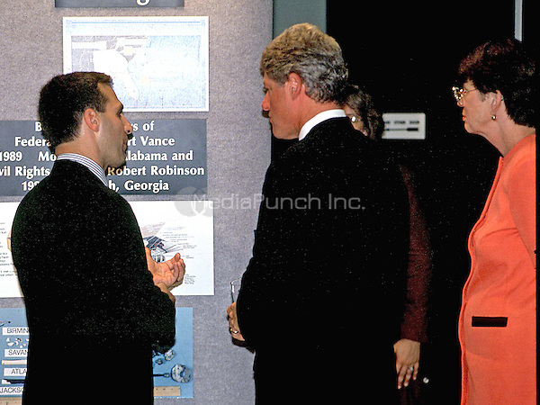 FBI Director Louis J. Freeh, left, conducts a tour of the FBI Headquarters in Washington, DC for United States President Bill Clinton, center, and Attorney General Janet Reno, right, after he was sworn-in as director on September 1, 1993.<br /> Credit: Ron Sachs / CNP /MediaPunch