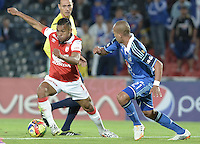 BOGOTÁ -COLOMBIA, 31-08-2014. Juan Esteban Ortiz (Der) jugador de Millonarios disputa el balón con Wilson Morelo (Izq) jugador de Independiente Santa Fe durante partido por la fecha 7 de la Liga Postobón II 2014 jugado en el estadio Nemesio Camacho el Campín de la ciudad de Bogotá./ Juan Esteban Ortiz (R) player of Millonarios fights for the ball with Wilson Morelo (L) player of Independiente Santa Fe during the match for the 7th date of the Postobon League II 2014 played at Nemesio Camacho El Campin stadium in Bogotá city. Photo: VizzorImage/ Gabriel Aponte / Staff