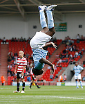Manchester City's Micah Richards celebrates his goal by completing a summersault