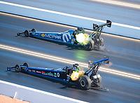 Nov 3, 2019; Las Vegas, NV, USA; NHRA top fuel driver Leah Pritchett (top) defeats Cameron Ferre during the Dodge Nationals at The Strip at Las Vegas Motor Speedway. Mandatory Credit: Mark J. Rebilas-USA TODAY Sports