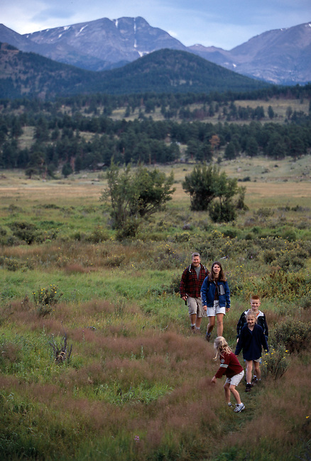 Family of five hiking along trail, Moraine Park, Rocky Mtn Nat'l Park, CO