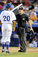 Umpire Ryan Additon explains a call to Dunedin Blue Jays manager Bobby Meacham (20) during a game against the Fort Myers Miracle on July 20, 2013 at Florida Auto Exchange Stadium in Dunedin, Florida.  Fort Myers defeated Dunedin 3-1.  (Mike Janes/Four Seam Images)