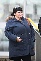 """Pictured: Kay Smith leaving Merthyr Crown Court during her trail.<br /> Re: Kay Smith who stole almost £12,000 from Merle Morgan, an elderly widow before her death has been jailed for 15 months at Merthyr Crown Court.<br /> Kay Smith treated her 79-year-old friend as an """"easy source of money"""", the court was told.<br /> The 54-year-old defendent from the Cilfynydd of Pontypridd, south Wales, was given access to the bank account belonging to Mrs Morgan, who was the sister of former world champion darts player Leighton Rees.<br /> When Mrs Morgan's husband died, she gave """"third party authority"""" over her bank account to Smith, for help with finances.<br /> But she withdrew thousands of pounds during the time leading up to Mrs Morgan's death."""